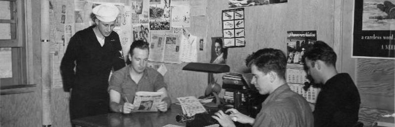Jack Gordon (at typewriter) and staff aboard NAS Pasco Sky-Writer