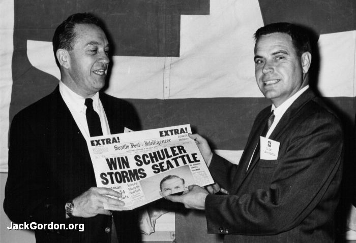 Win Schuler and Dick Lenington holding a Seattle P-I